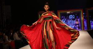 New Delhi: A model walks the ramp during the 'Rainbow Show' at Grand Finale of Lotus Make-up India Fashion Week, in New Delhi on Oct 13, 2018. (Photo: Amlan Paliwal/IANS)