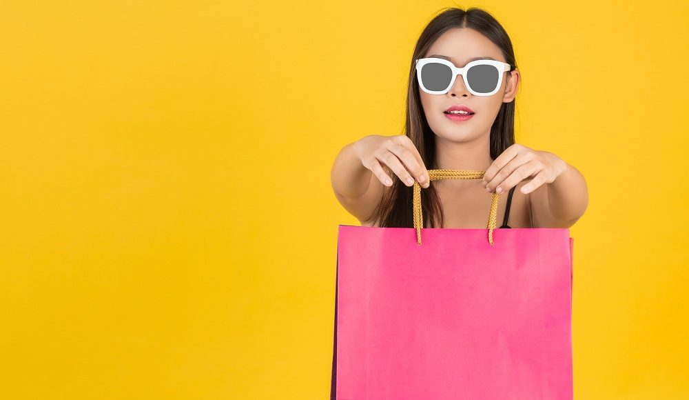 Shopping concept of beautiful women wearing glasses with colorfu